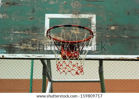 Basketball hoop against the warm summer  - stock photo