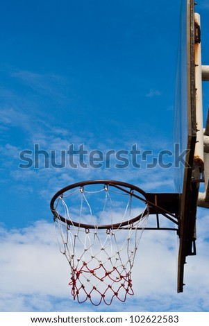 basketball hoop at its backboard against blue sky - stock photo
