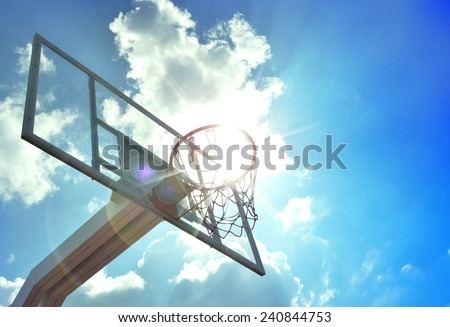 Basketball hoop in the blue sky - stock photo