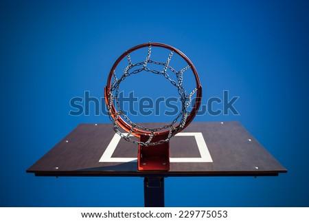 Basketball hoop on a blue sky background  - stock photo