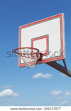 Basketball hoop on blue sky background - stock photo