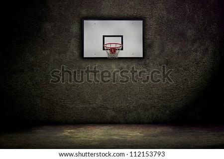 Basketball hoop on empty outdoor court - stock photo