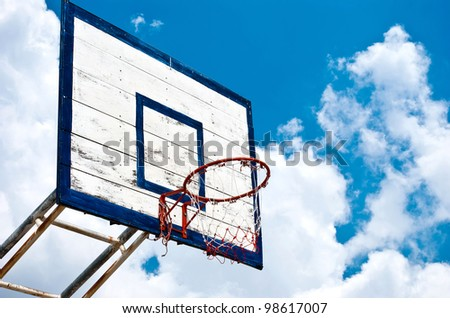 Basketball hoop with blue sky - stock photo