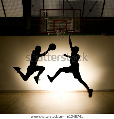 Basketball jump - black silhouettes - stock photo