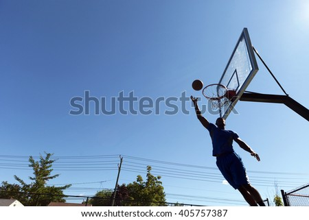 Basketball Layup Silhouette - stock photo