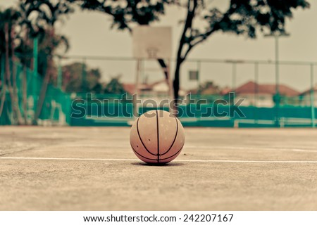 Basketball on urban court. Vintage style - stock photo