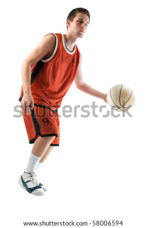 Basketball player dribbling the ball - stock photo