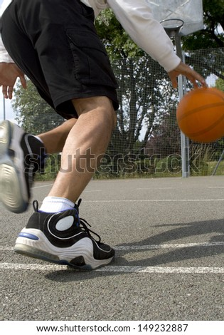 Basketball Player Driving to the Hoop - stock photo