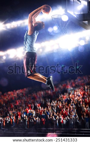 Basketball player in action is flying high and scoring - stock photo