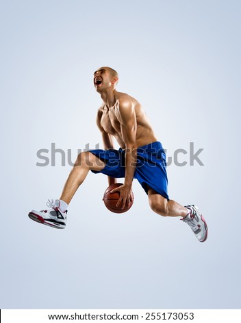 Basketball player in action isolated on white background - stock photo