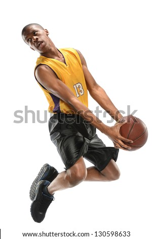 Basketball player jumping isolated over white background - stock photo