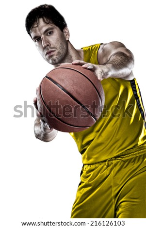 Basketball player on a  yellow uniform, on a white background. - stock photo