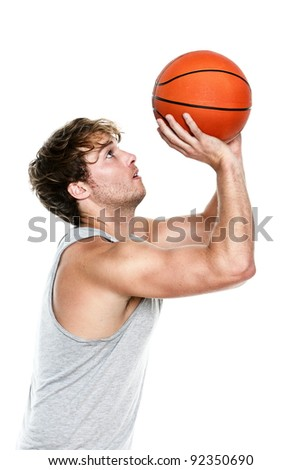 Basketball player shooting isolated on white background. Muscular fit young Caucasian sport fitness model in his 20s. - stock photo