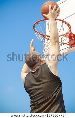 Basketball player throw the ball - stock photo