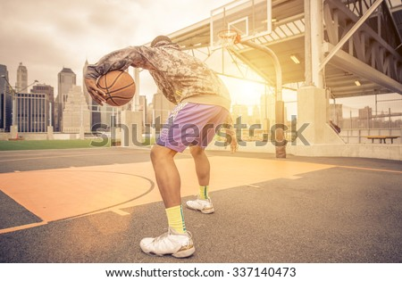 Basketball player training on the court. concept about basketball and sport - stock photo