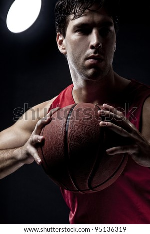 Basketball player with a ball in his hands - stock photo