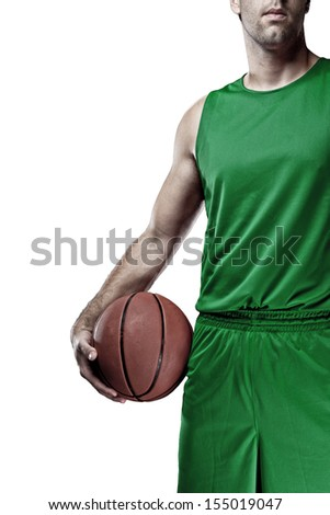 Basketball player with a ball in his hands and a Green uniform. On a white Background - stock photo
