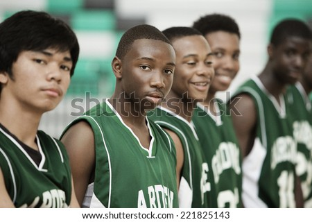 Basketball players standing in row - stock photo