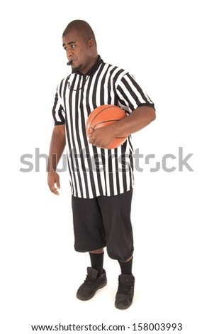 Basketball referee with basketball blowing the whistle - stock photo