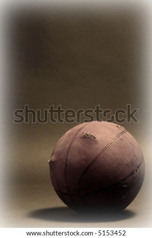 basketball  resting on the  floor - stock photo