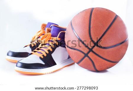 Basketball shoes  with Basketball - stock photo