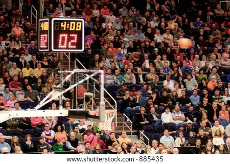 Basketball Stadium with ball approaching the basket (exclusive at shutterstock) - stock photo