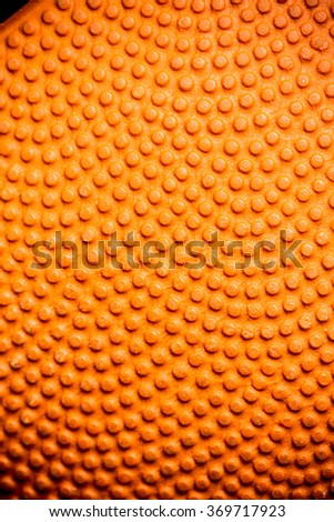 Basketball Textured. Sport and Recreation. Macro, Close up, Selective View. Full Frame for Background, Pattern, Wallpaper and Textures. - stock photo