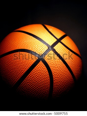 basketball with a dark background - stock photo