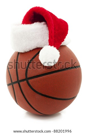 Basketball With Red Santa Hat On Top - stock photo
