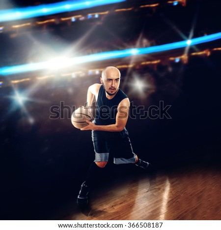 Basketballer in action with a ball. . Basketball game. Sportsman plays basketball. - stock photo