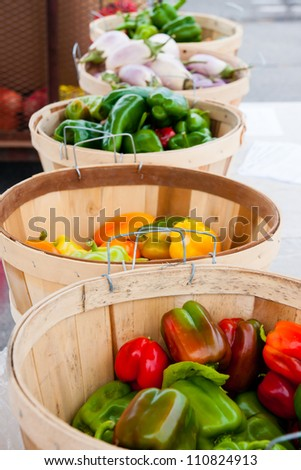 Baskets filled with fresh produce at a Farmer's market stand - stock photo