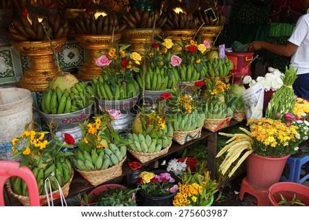 Baskets of green bananas and coconuts for donation in  Botataung Pagoda, Yangon,  Myanmar (Burma) - stock photo