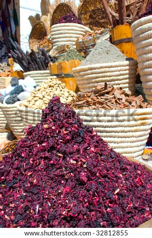 Baskets with spicery and carcade on east bazaar - stock photo