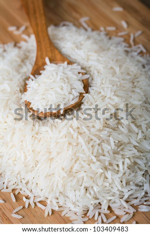 Basmati rice with spoon - stock photo
