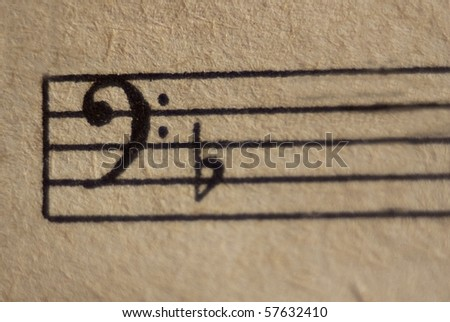 Bass clef with flat on a stave close up - stock photo