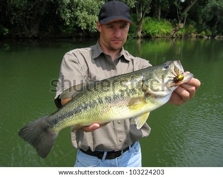 Bass fisherman - stock photo