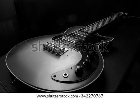 Bass guitar, musical instrument - stock photo