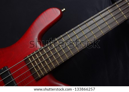 Bass guitar with red body - stock photo