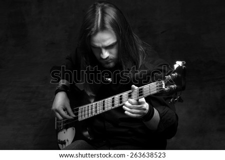 bass guitarist and his instrumnet - stock photo