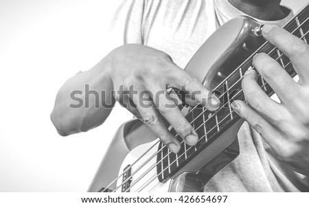 bass player, isolated on white + vintage BW filter - stock photo
