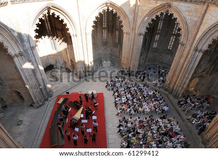 BATALHA, PORTUGAL - SEPTEMBER 19: House of Music Baroque Orchestra , Portugal musical group active in the party town and Monastery Batalha of Batalha on September 19, 2010 in Batalha, Portugal. - stock photo