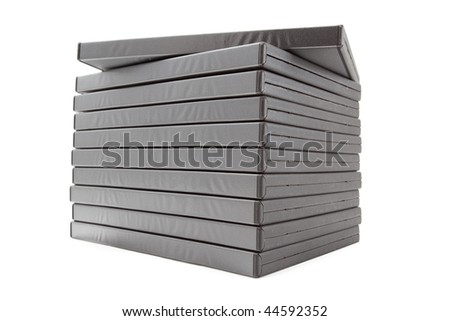 Batch of DVD movies in packing boxes isolated on white background - stock photo