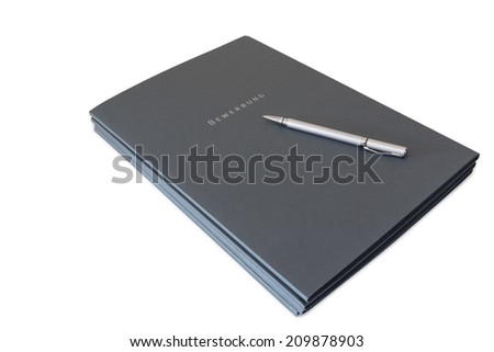 Batch of job application files and a silver pen isolated on white background - stock photo