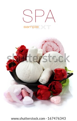 Bath and spa Valentine theme with thai herbal compress stamps, towel, bath soaps and tulips (with easy removable text) - stock photo