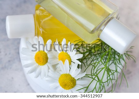 bath - aromatherapy - herbal healing lotion - camomile  - stock photo