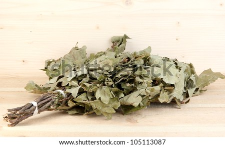Bath broom of oak on wooden background - stock photo