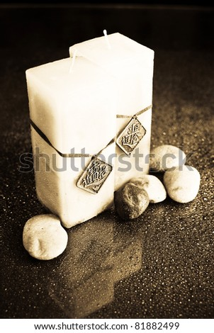 Bath Candles in Sepia with Rocks - stock photo