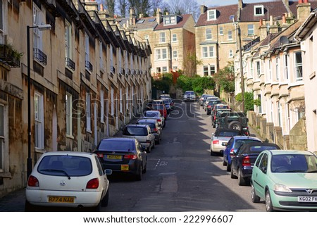 Bath City, UK - March 30 2014: Car parking along the road beside resident houses.Bath is a city in Somerset located in South West England, 97 miles west of London and 13 miles south-east of Bristol. - stock photo