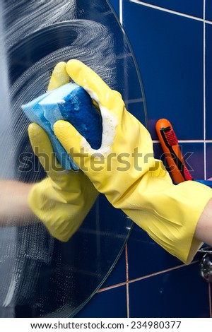 bath cleaning rubber gloves - stock photo