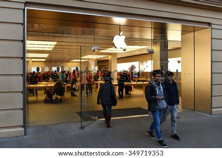 BATH - DEC 9: People shop at an Apple Store on a street in the city's shopping district on Dec 9, 2015 in Bath, UK. Retailers reported busy seasonal trade in the run-up to Christmas. - stock photo